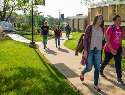 students walking down a campus path