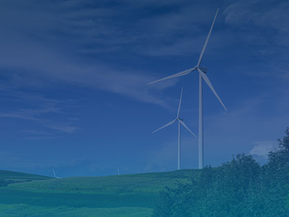 A photo of wind turbines on a hill