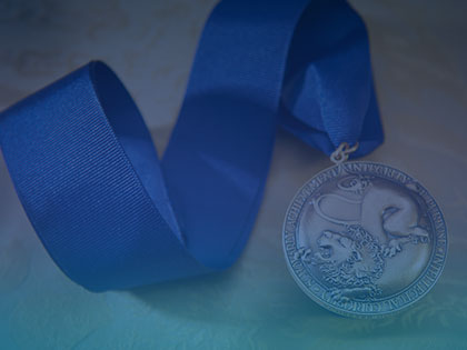 A photo of a Schreyer Honors College medal
