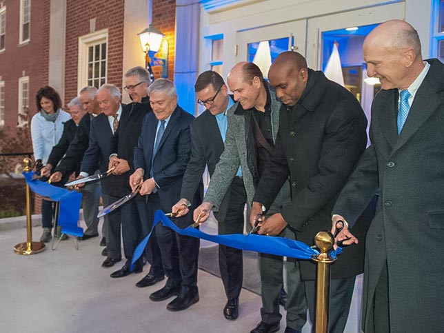 Penn State President Eric Barron and University leadership cut a ribbon at a building opening