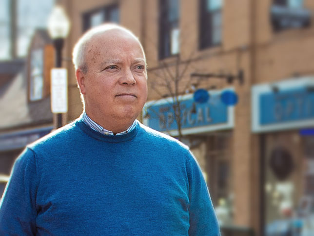 Penn State professor Tom Sharbaugh walks in downtown State College
