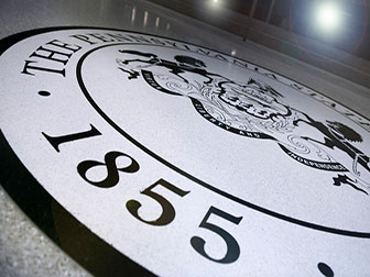 A photo of the Penn State seal on the floor of the HUB-Robeson Center